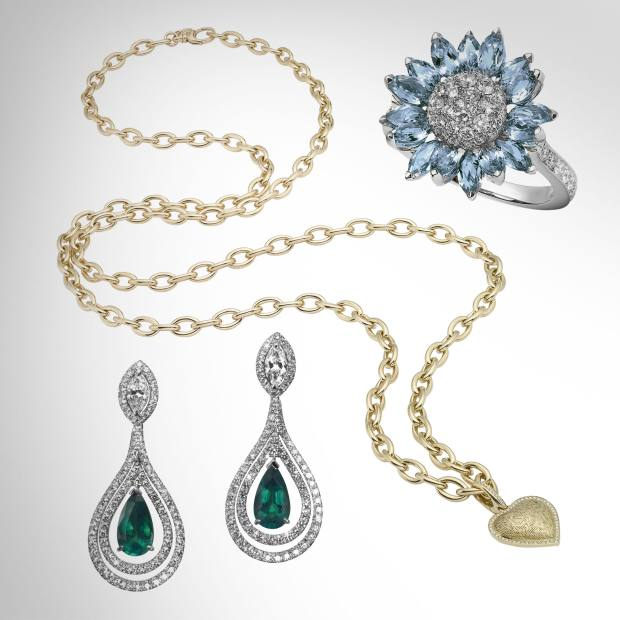 From top: white gold Daisy Heritage ring with aquamarines and diamonds, £5,000. Gold Woodland necklace, £17,000, and charm with diamonds, £2,800. Platinum earrings with emeralds and diamonds, £55,000