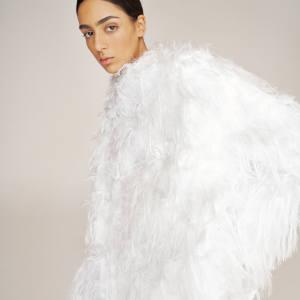 Nora Attal wears Dior mixed-fibre coat,£4,300