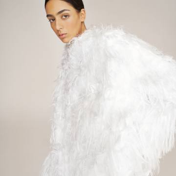 Nora Attal wears Dior mixed-fibre coat, £4,300