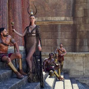 Alexander McQueen embroidered silk chiffon cape, embroidered silk tulle gown and embroidered silk tulle bra, all price on request. Embroidered velvet platform sandals (just seen), £1,195. Harvy Santos feather, glass and gilt pastille headpiece, made to order, price on request. Chopard platinum, diamond and emerald Haute Joaillerie necklace, and Fairmined gold and diamond Green Carpet bracelet, both price on request