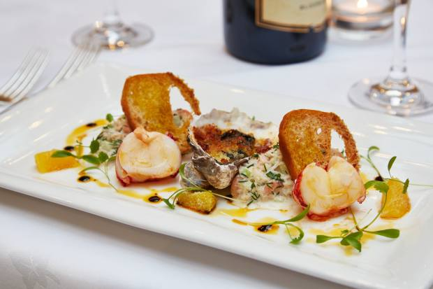 "Chef Russell Williams' ""Flavour of Sussex"" menu, £68 per person, features scallops, lobster and seabass"