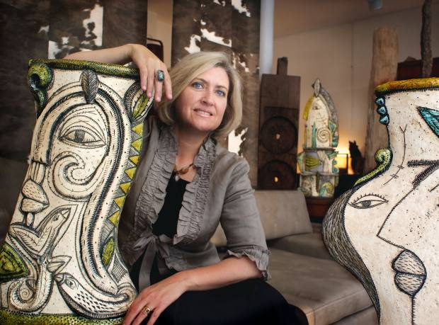 Ceramicist Charmaine Haines with portrait vessel (left) R13,000 (about £800) and portrait vessel with birds, about £750