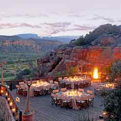 Bushmans Kloof is a wilderness lodge set amidredcliffs and vast plains grazed by antelope
