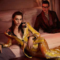 She wears Gucci sequin embroidered silk jacquard jacket, £4,040, and matching trousers, £1,220. Emma Hope embroidered silk, velvet and leather ballet pumps, £379. Van Cleef & Arpels gold and carnelian Vintage Alhambra 5 Motifs bracelet, £3,600. He wears Budd Shirtmakers silk dressing gown, £950, silk scarf, £295, and silk pocket square, £55. Lanvin cotton shirt, £725. Louis Vuitton mohair/wool/silk trousers, £695. Cutler and Gross 1239 glasses, £295