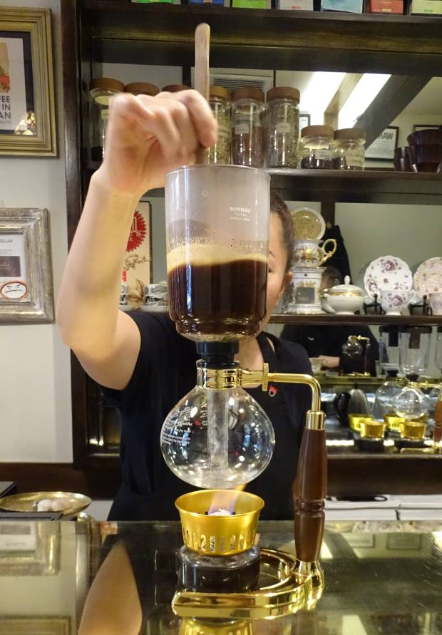 The laboratory-like experience of a siphon coffee, $6.50, being prepared