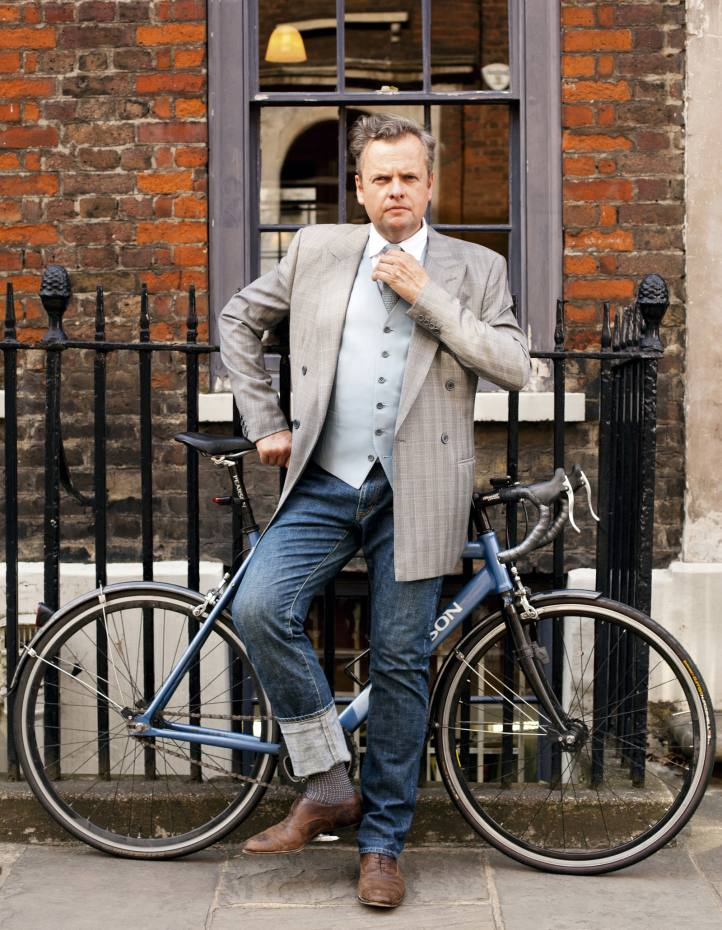 Timothy Everest, outside his atelier in Shoreditch, wearing a selection of his own bespoke cycling-friendly designs