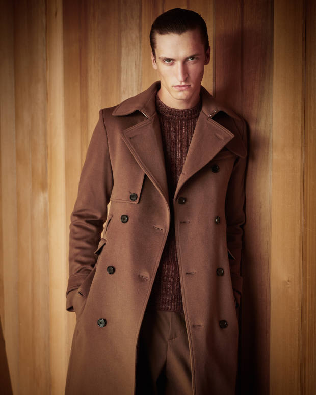 Dior Homme wool coat, £2,700, and matching trousers, £840. John Smedley alpaca/merino-wool/viscose Salke jumper, £285