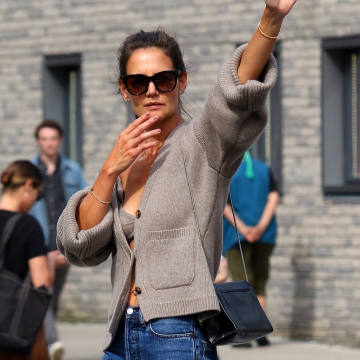 Katie Holmes wearing a Khaite cashmere cardigan and bra in New York