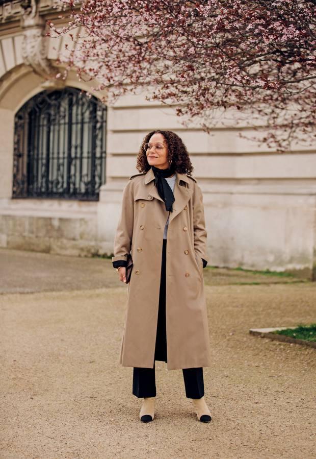 Samira Nasr wears a Celine trench coat