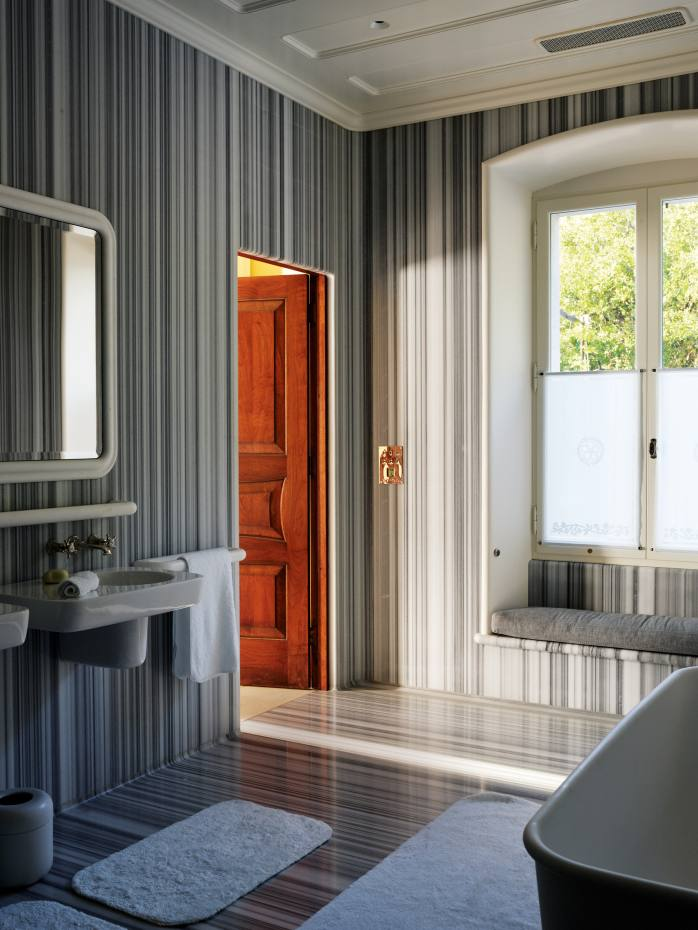 The master bathroom at Marc Newson's Ithacan home, clad in Striato Olimpico marble