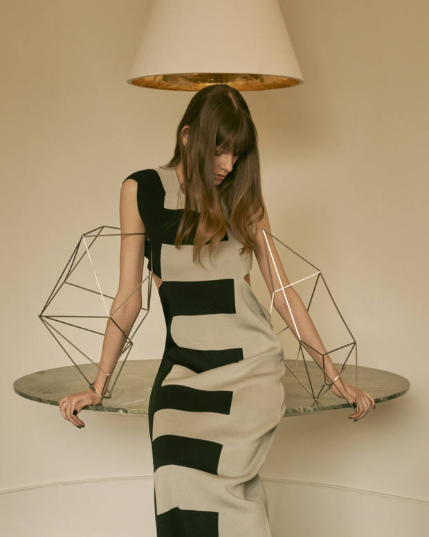 Gilded plaster cone hanginglight, £3,576, andSwedish green marble Centre table, £30,000, bothfrom Rose Uniacke. Rick Owens silk dress, £1,558, and brass Babel bracelets, £657 (right arm) and £608 (left arm)