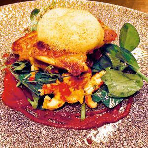 Pan-roasted chicken thigh with crayfish and a curry foam is a highlight at the Varsity