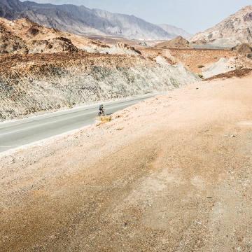 The race runs through barren deserts and thundering peaks