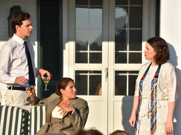 Actor Patrick Walshe McBride with Revels in Hand co-founders Lucy Eaton (left) and Melanie Fullbrook performing Coward at an intimate cocktail party
