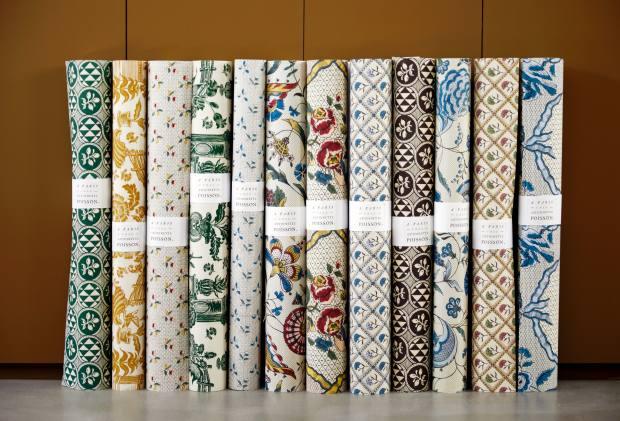Rolls of printed wallpaper in the boutique
