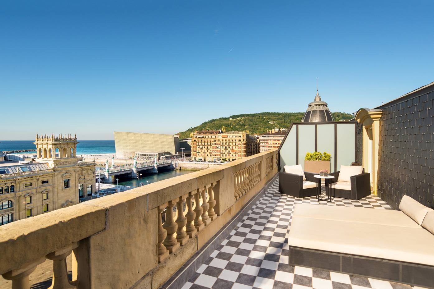 A terrace suite at Hotel María Cristina in San Sebastián, with views of the Zurriola bridge and the Kursaal building