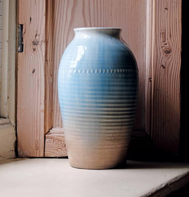 A c1920 natural pottery vase