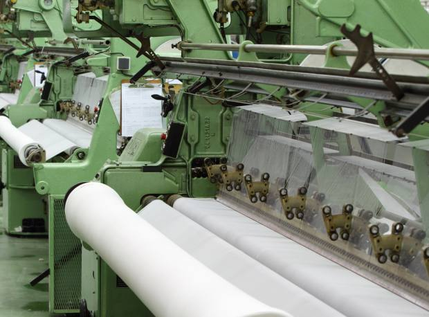 Quality 75 was invented by Peter Hill to provide an alternative to the heavy piqué cottons used in the 1950s. It is still crafted on warp knitting machines dating back to the 1960s