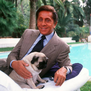Valentino Garavani with his pug at home in Rome, 29 September 2000