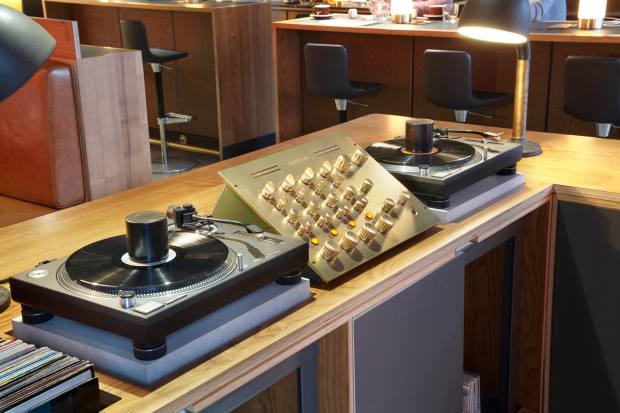 Spiritland's Kuzma turntable and beyond-beautiful solid-brass mixer (made in collaboration with design agency Pentagram)