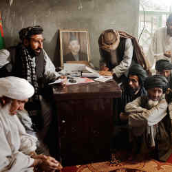 The new district chief meets with elders in Marja, Helmand Province, Afghanistan, 2010, by Moises Saman