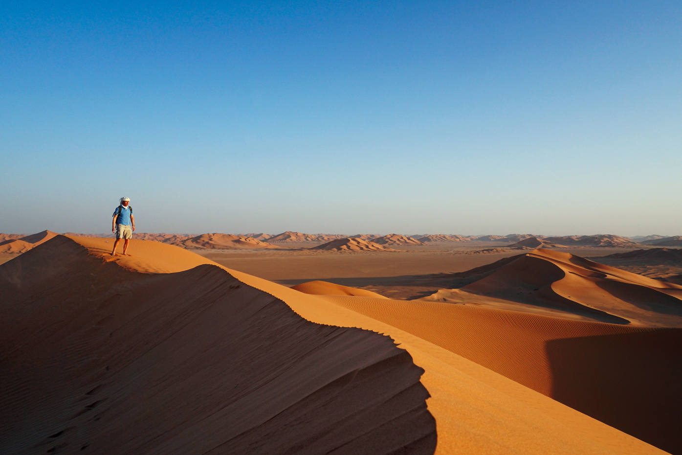 The author atop a 200m-high dune in Oman's Empty Quarter