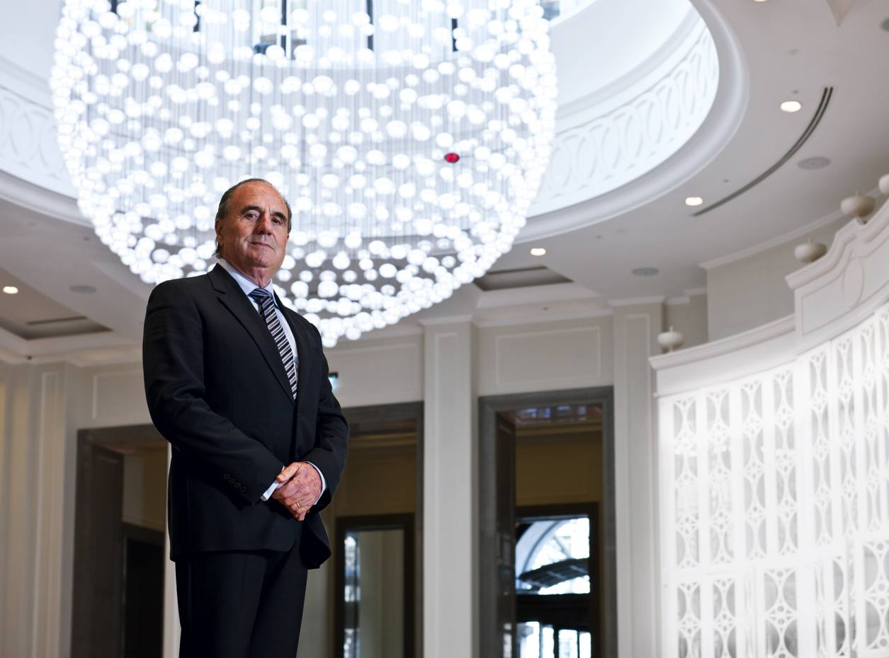 Alfred Pisani in the lobby of the Corinthia London, with a chandelier commissioned from Baccarat.