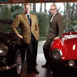 Karl-Friedrich Scheufele (left) and Peter Bradfield, with Scheufele's black 1956 Alfa Romeo 1900 CSS and red 1955 Ferrari 750 Monza
