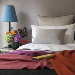 Josephine Home Classic 500-thread-count bed linen, from £32.50, and lambswool/angora throws, from £195
