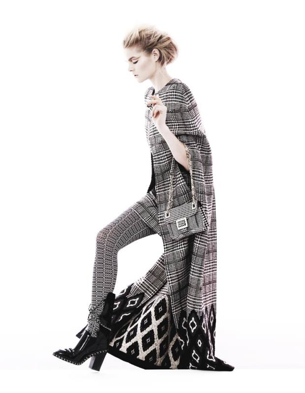 Wool-plaid and Jacquard cape, £5,050, and matching dress, £1,260, both by Blumarine. Polyester-mix tights, £17.75, by Oroblu from MyTights. Leather boots with chain detail, £2,100, by Chanel. Ponyskin-effect bag, £1,850, by Roger Vivier