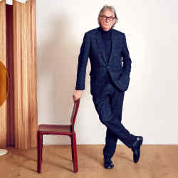 Paul Smith with one of his Mario Bellini-designed 412 CAB chairs