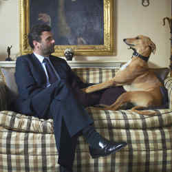 Trevor Pickett and his lurcher, Chino, at home in London