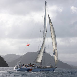 Challenger 4, sailing for Tall Ships Youth Trust, approaches the finish line in St Lucia, 2016