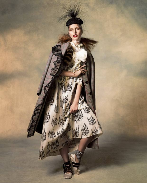 Miu Miu silk/wool and tulle coat, £1,790, silk dress, £2,295, silk and leather shoes, £365, feather and crystal necklace, £570, and fox fur and Plexiglas charm, £290. Rosie Olivia beaded straw beret, £550