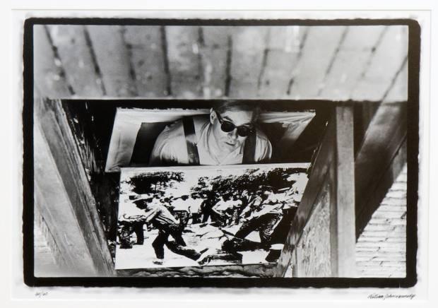 Warhol with his Birmingham Race Riot sandwich board