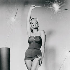 Marilyn Monroe poses with sparklers