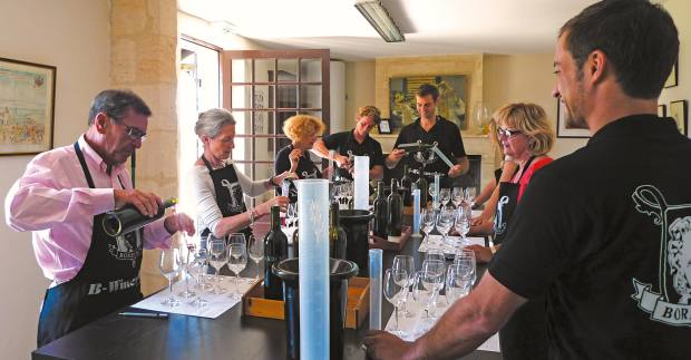 Guests blending wines at one of theB-Winemaker experiences, held by Magrez's Château Pape Clément winemakers