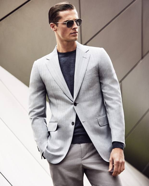 Dunhill wool/silk jacket, £975, and cotton trousers, £220. John Smedley merino wool Lundy jumper, £145. Persol at David Clulow sunglasses, £243