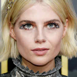 Lucy Boynton in Louis Vuitton at the 2020 Golden Globes, with eyes by make-up artist Jo Baker