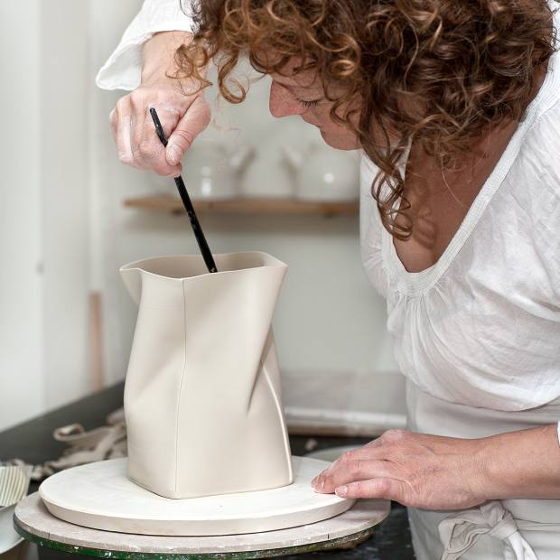 Ceramicist Inge Vincents crafting one of her creations