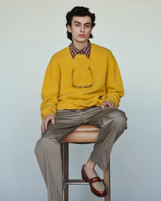 Joel wears Etro wool jumper, £355, cotton shirt, £345, and wool chinos, £340. Crockett & Jones calfskin and canvas Richmond II loafers, £425. Cutler and Gross Havana glasses, £31