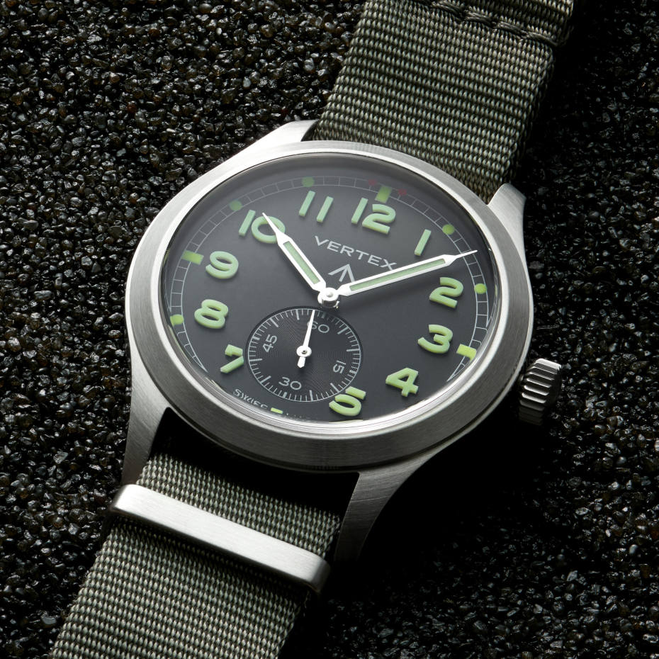 "The Vertex M100's black dial with highly luminous Arabic numerals, small seconds counter and ""broad arrow"" government property mark hark right back to the old military-issue models"