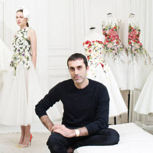 Giambattista Valli at his Rue Boissy d'Anglas atelier in Paris. Couture evening dresses, from far left: silk cloqué embroidered with cotton daisies and leaves; silk tulle with daisies and leaves; silk faille with mimosas and leaves; silk-jacquard with magnolias and geraniums. All price on request
