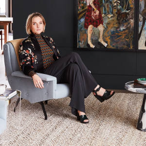 Sophie Ashby in one of the apartments she designed at No 3 Upper Riverside, on Greenwich Peninsula, featuring a painting by Fabienne Jacquet – Ashby uses art as the starting point on her projects