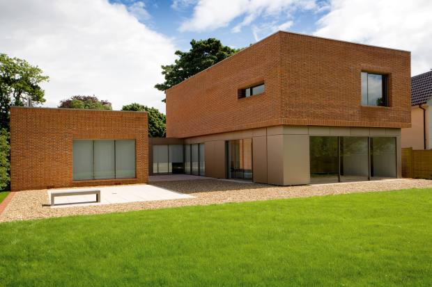 Handmade brick softens the linear design of James Gorst's Brick House in Suffolk