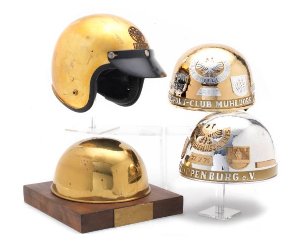 Two German International Long Track helmet awards with spun brass example and open face helmet, estimated at £800 to £1,200