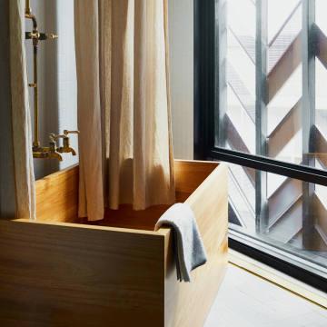 The bathrooms at theParamount House Hotel inSydney have Japanese cedar bathtubs