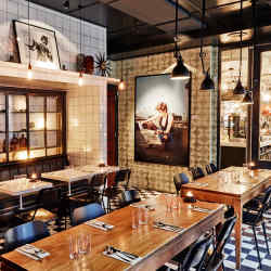 Kolonialen is set in an early-20th-century grocery store with original black and white floor tiles and a mix of marble-topped and wooden tables