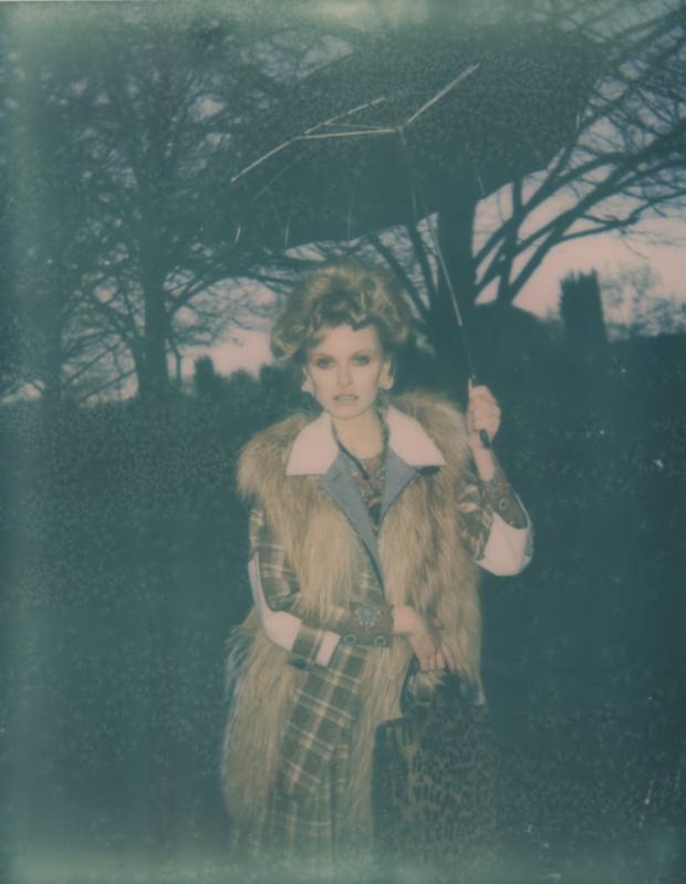 Wool and cashmere jacket, £1,690, wool and cashmere skirt, £1,550, and fox fur gilet, £10,700, all by Louis Vuitton. Viscose top, £150, by Kenzo. Ungaro 1970s vintage pony hair leopard print bag, £650, from Atelier Mayer. Lacquered resin, metal and strass necklace, £820, by Lanvin. Kenneth Jay Lane 1950s vintage resin rose ear clips, £480, from Atelier Mayer. Umbrella stylist's ownAtelier Mayer, 47 Kendal Street, London W2 (020-7706 7200; www.atelier-mayer.com). Kenzo, 31 Bruton Street, London W1 (020-7491 8469; www.kenzo.com). Lanvin, 128 Mount Street, London W1 (020-7491 1839; www.lanvin.com) and branch/stockists. Louis Vuitton, 17-20 New Bond Street, London W1 (020-7399 4050; www.louisvuitton.com) and branches/stockists.