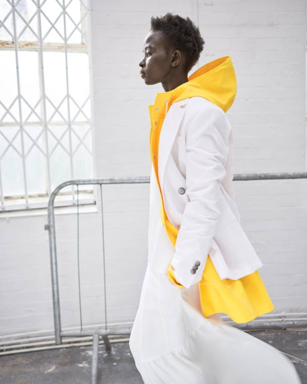 Boss silk jacket (sold as suit), £595, and cotton dress, £575. The Marc Jacobs rubberised cotton raincoat, £460